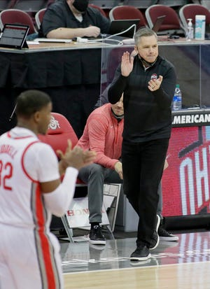 Ohio State Buckeyes head coach Chris Holtmann claps on the sideline during the second half of Wednesday's NCAA Division I basketball game against the Northwestern Wildcats at Value City Arena in Columbus, Oh., on Wednesday, January 13, 2021. Ohio State won the game 81-71.